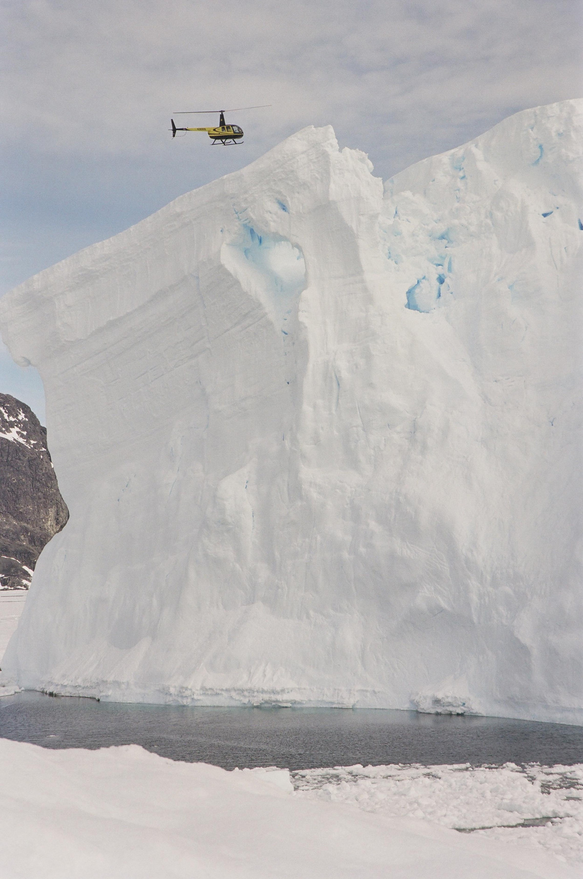 Helicopter over iceberg