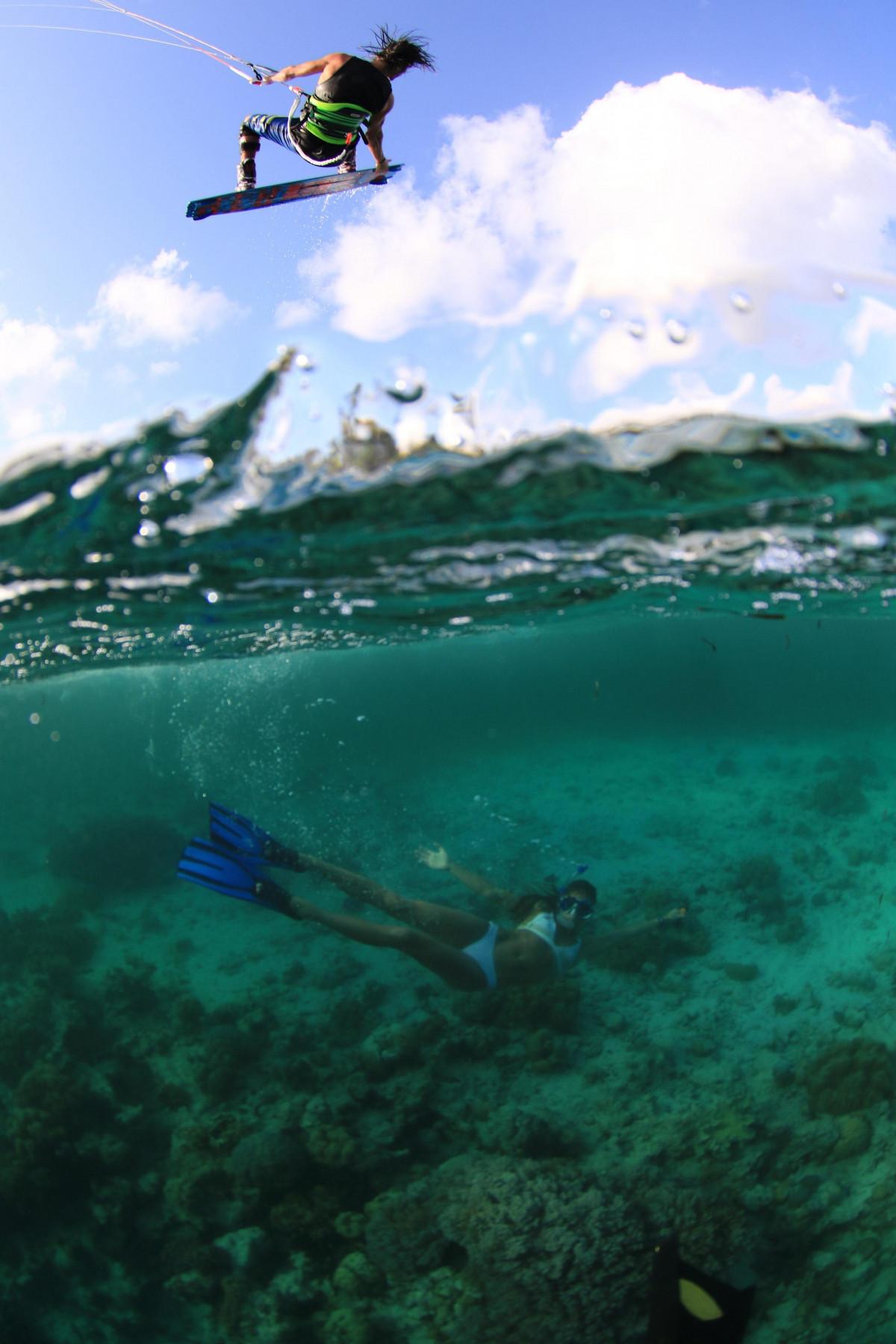 Tom Court kiting and writer Sophie Mathews underwater