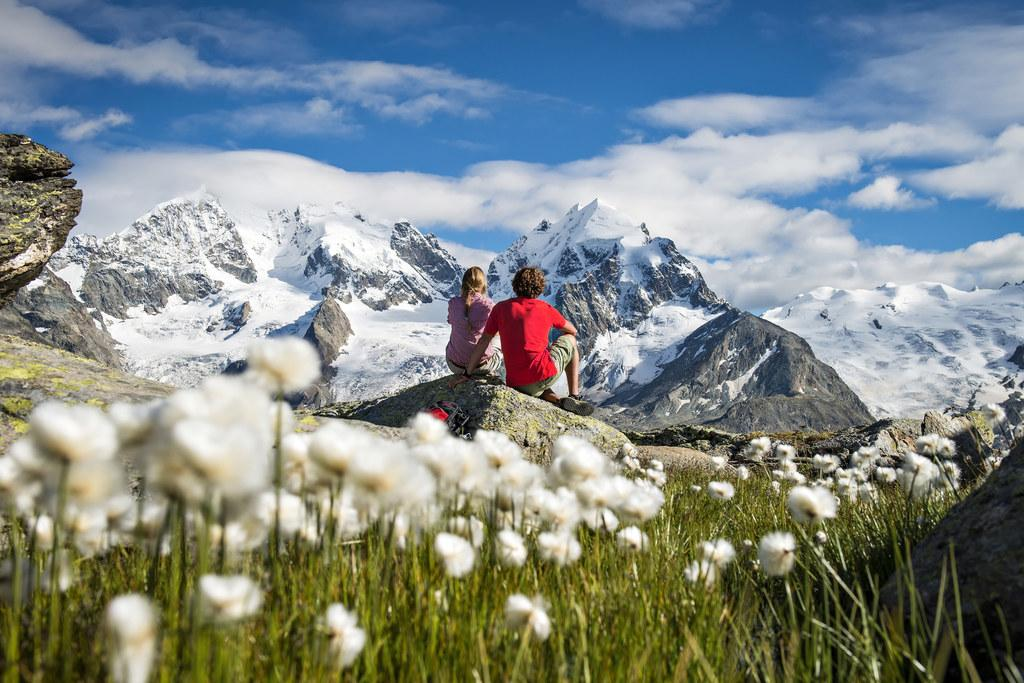 A stop to admire the views while hiking to Fuorcla Surlej, with Piz Bernina and Piz Roseg in the background