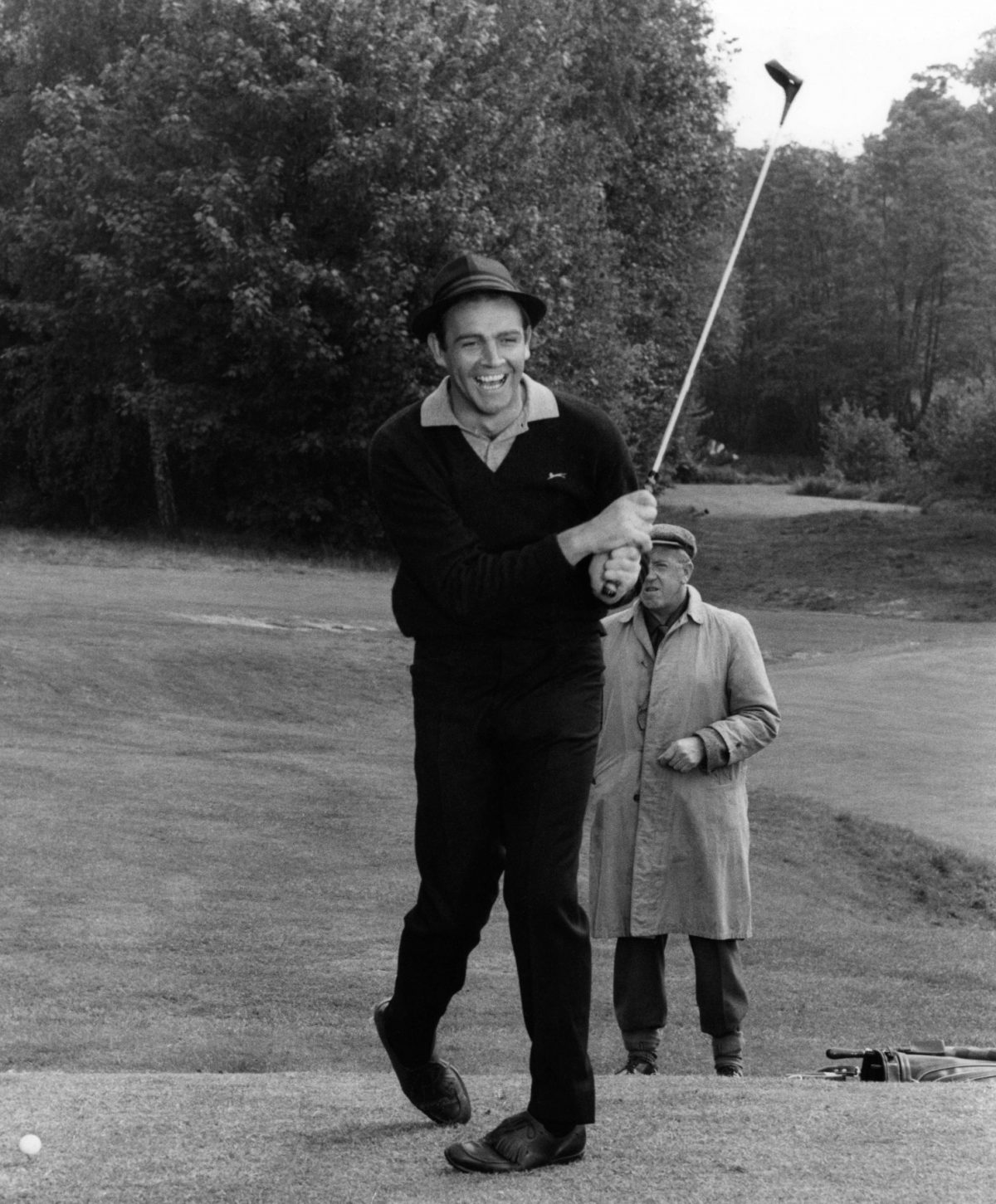 Sean Connery playing golf