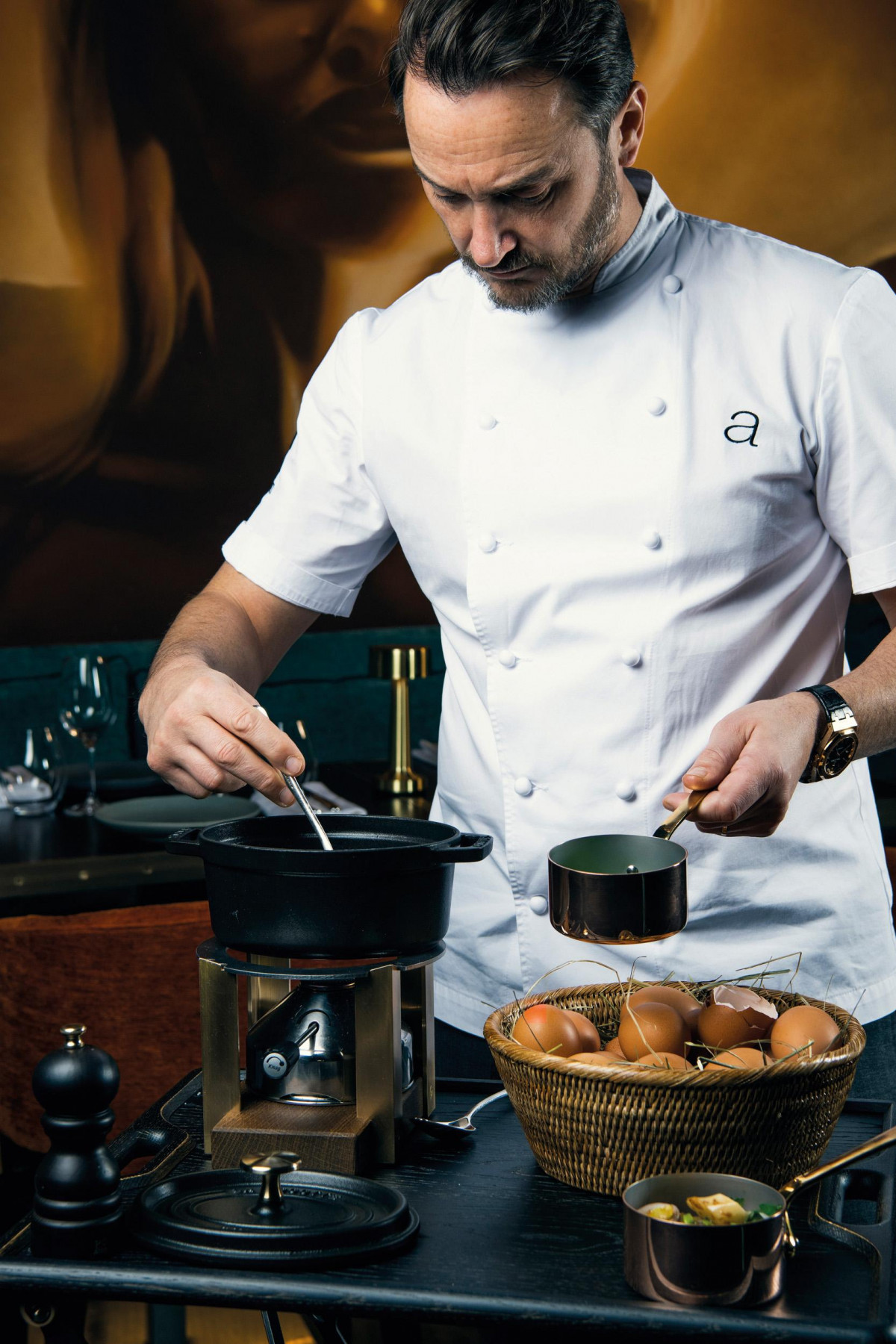 Jason Atherton prepares tableside at King's Social House, St. Moritz
