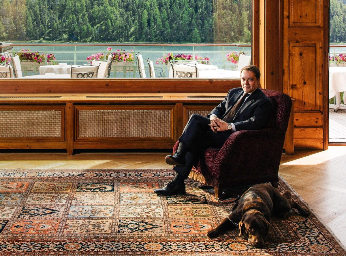 Richard Leuenberger relaxing in chair with dog