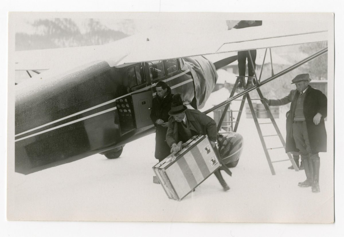 Passenger and plane on Lake St. Moritz