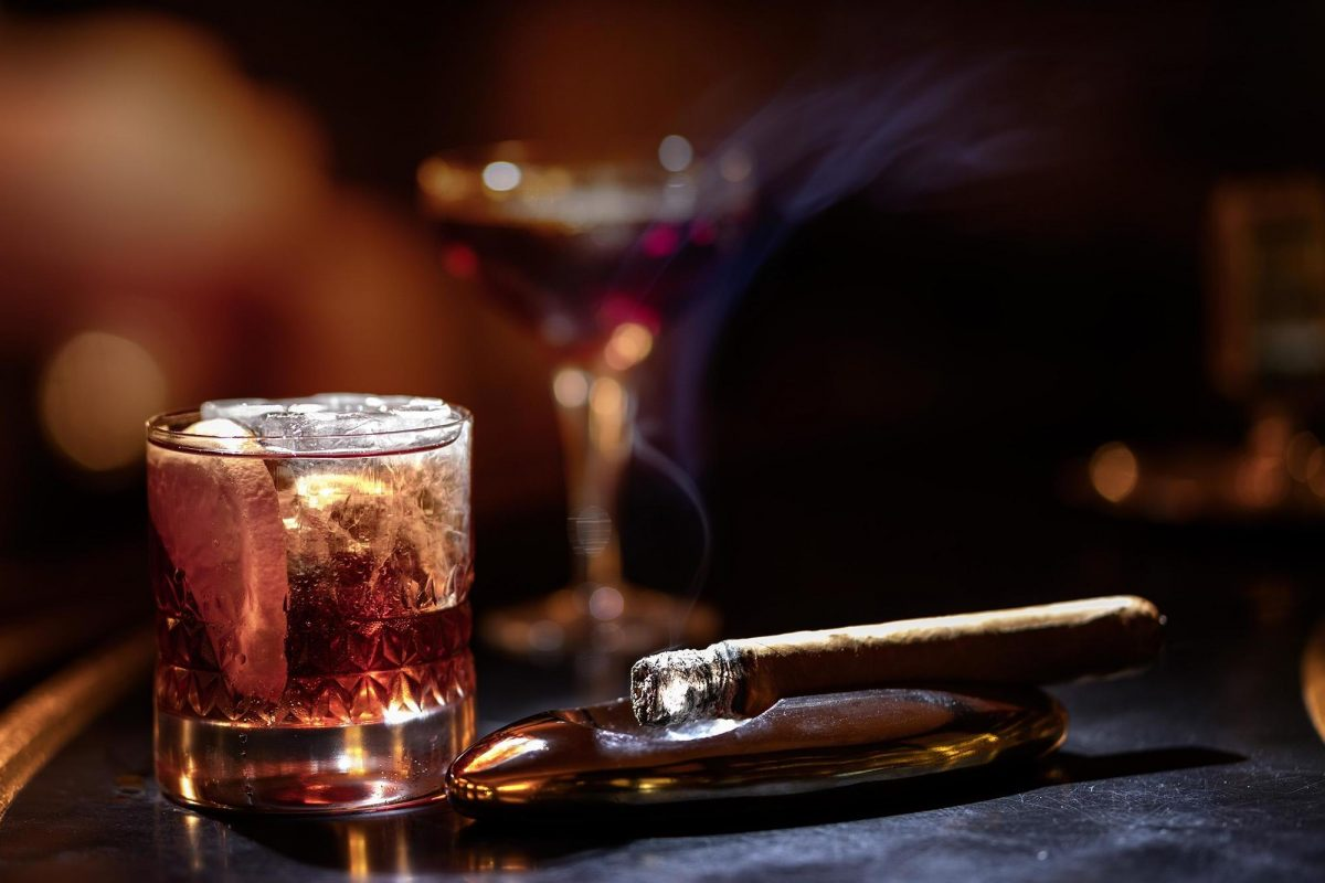 Alcoholic drink and cigar