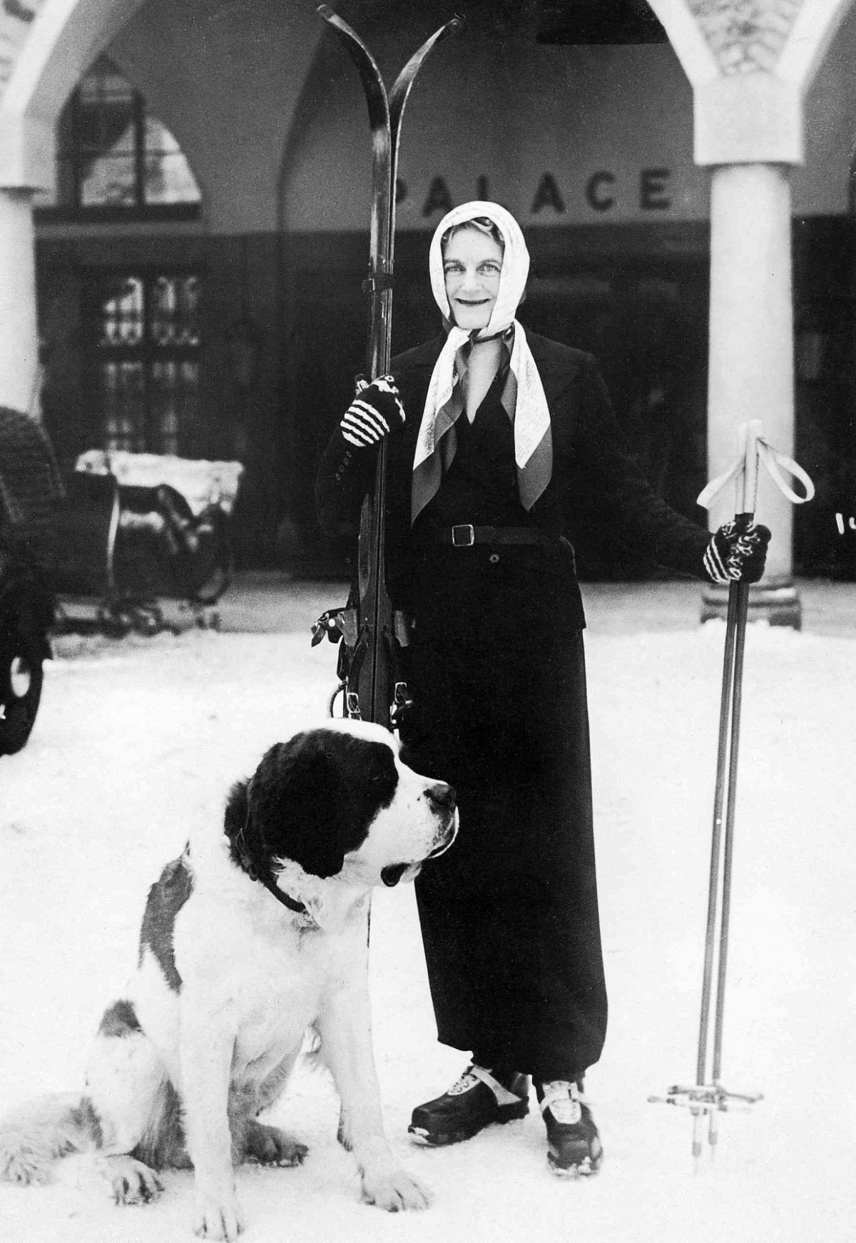 Black and white picture of Clementine Churchill and dog in St. Moritz Imagno/Getty Images