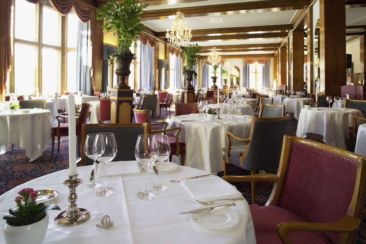 The dining room of Le Restaurant at Badrutt's Palace Hotel