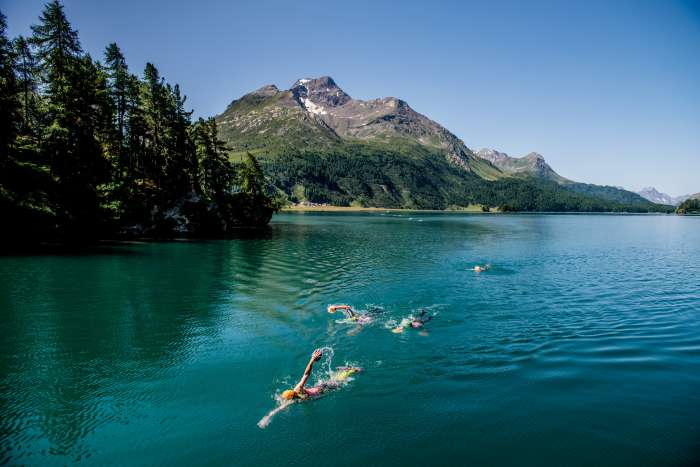 People wild swimming in a lake in the Engadin
